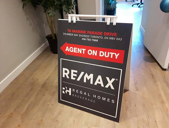 real estate marketing material agent on duty sign remax